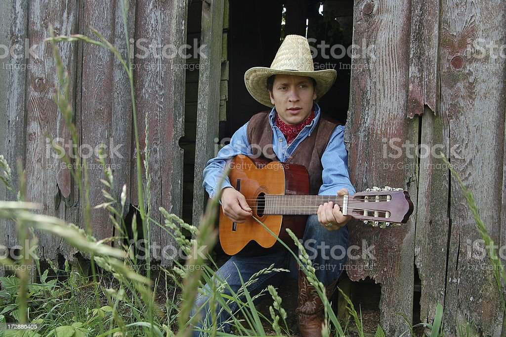 Cowboy Sits and Plays Guitar stock photo