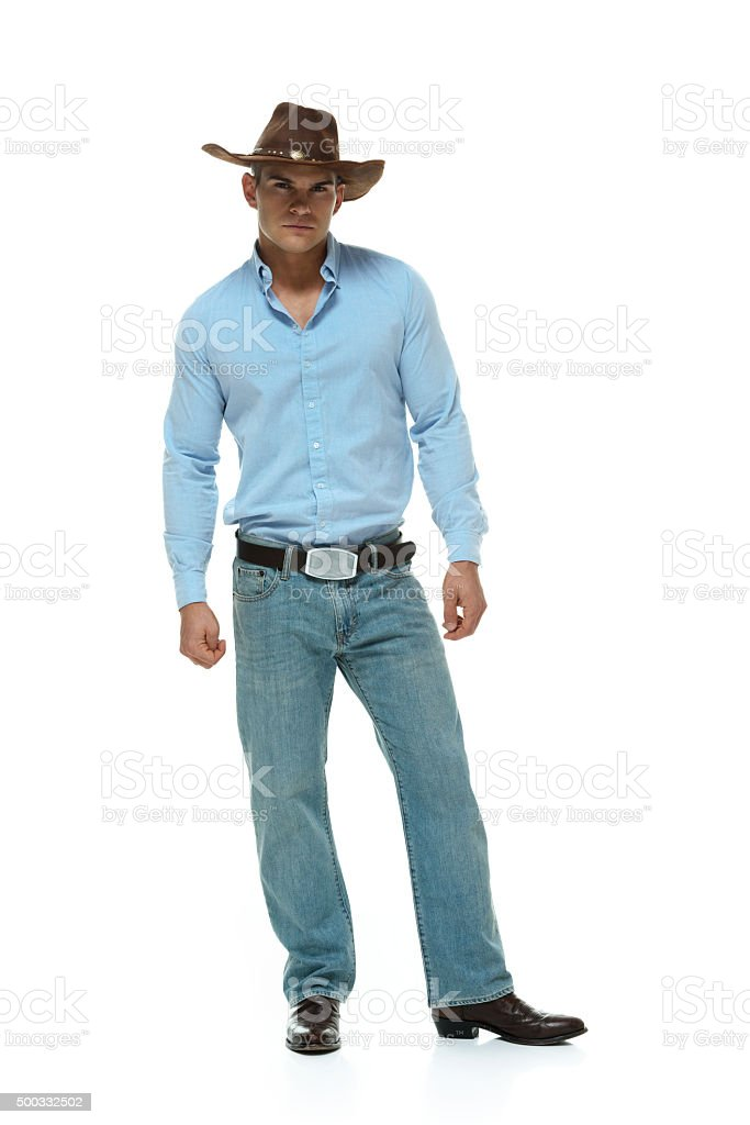 Cowboy standing and looking at camera stock photo