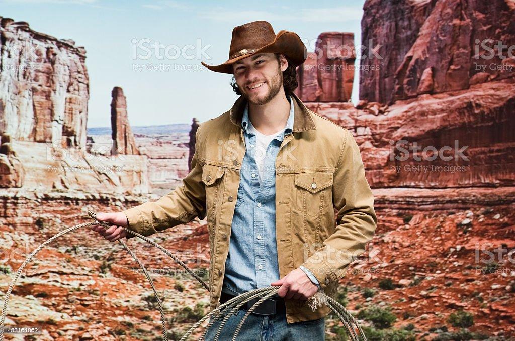 Cowboy standing on mountain stock photo