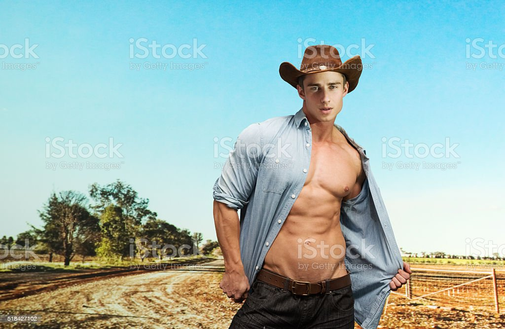 Cowboy standing out on the farm stock photo