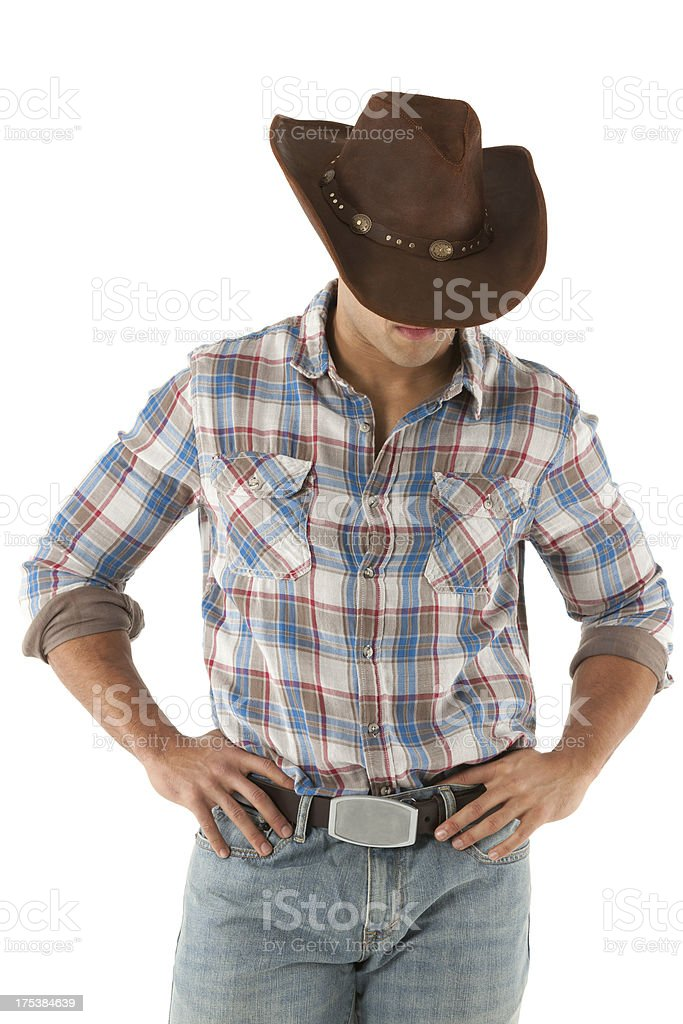 Cowboy standing with arms akimbo royalty-free stock photo