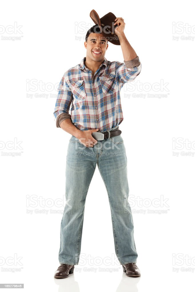 Cowboy tipping hat stock photo