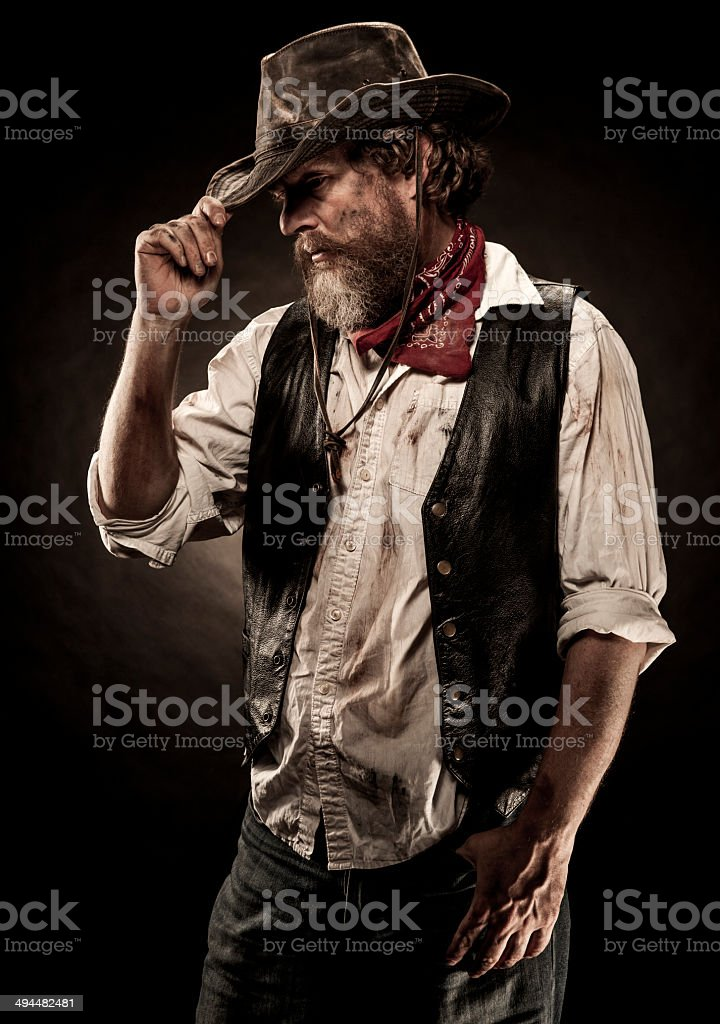 Cowboy Tipping His Hat stock photo