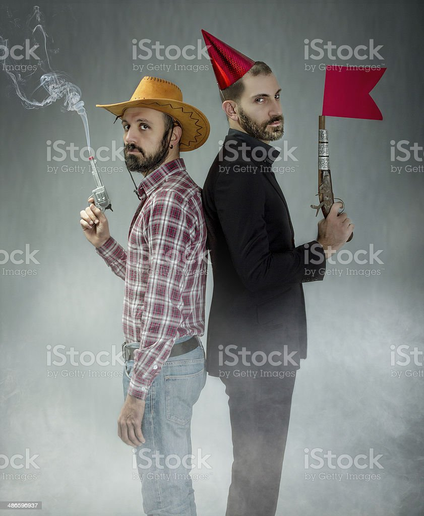 cowboy versus clubber in a far west funny version stock photo