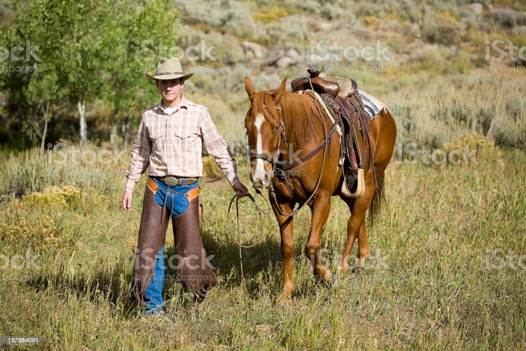 Cowboy Walking with his Horse stock photo