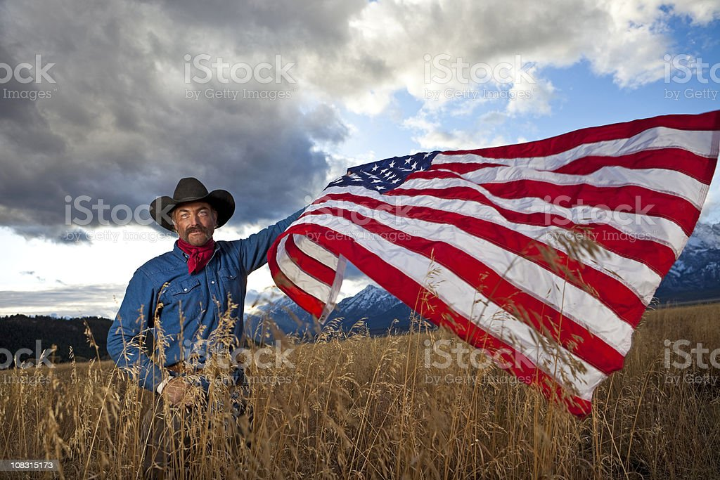 Cowboy with flag stock photo