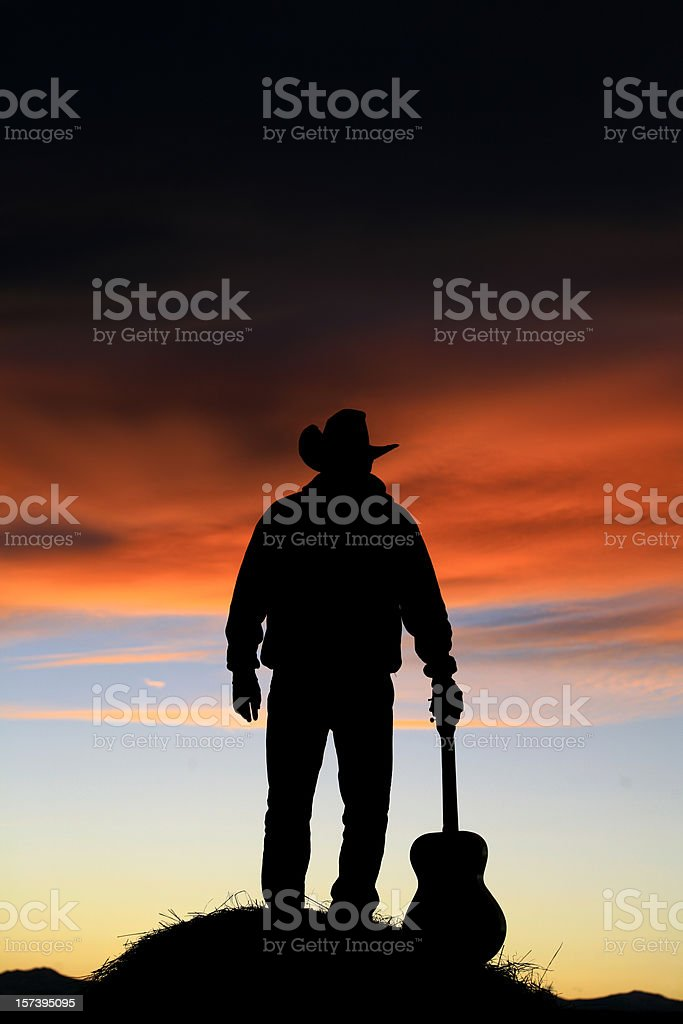 Cowboy with Guitar Vertical Image stock photo
