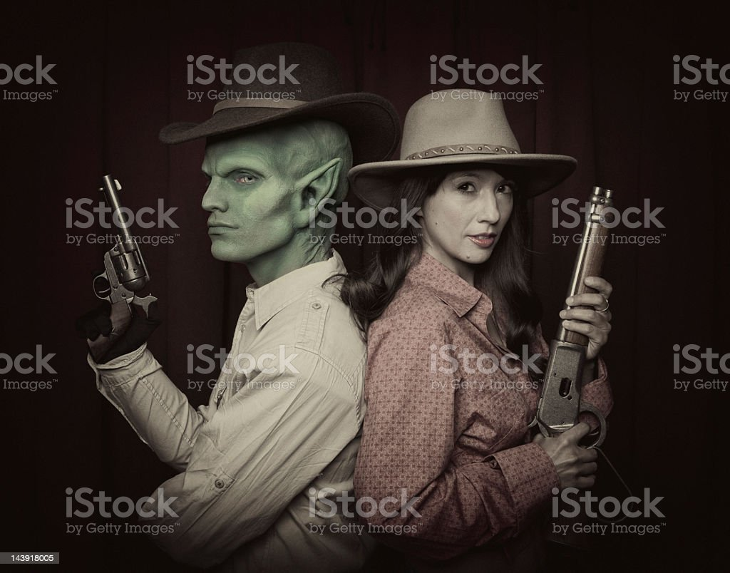 Cowboys and Alien stock photo