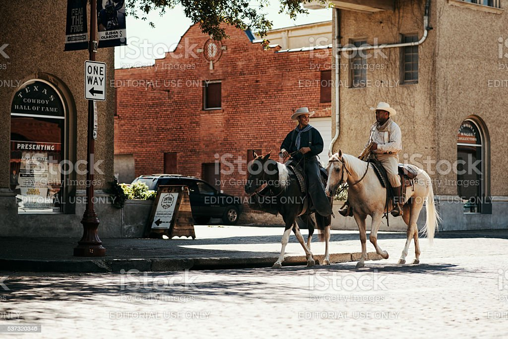 Cowboys on the Horses down streets at Fort Worth stock photo