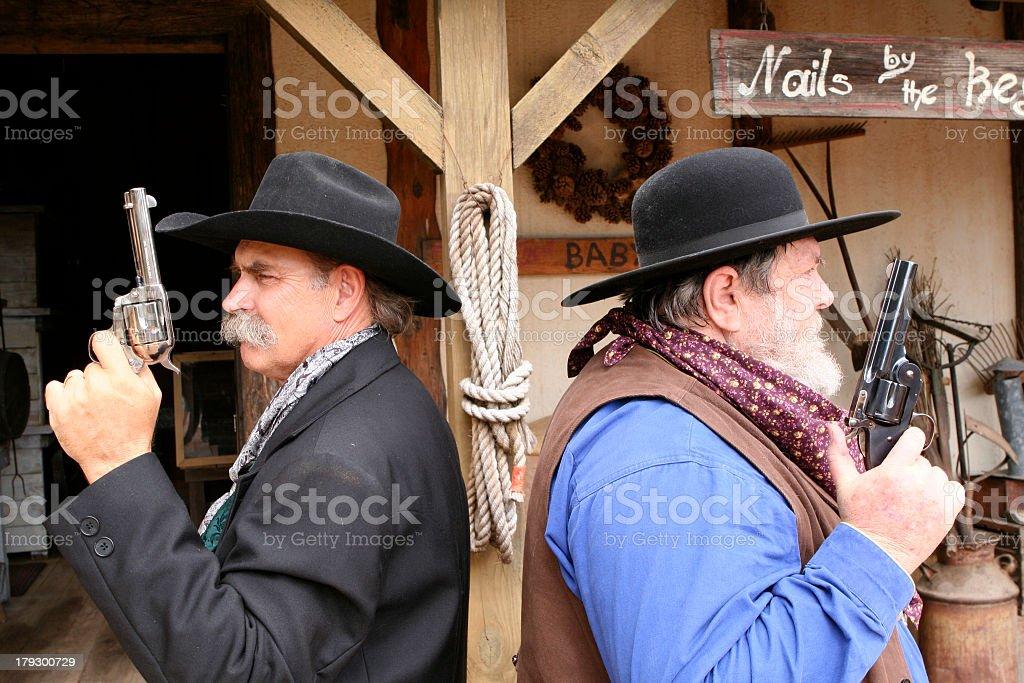 Cowboys prepping for a gun duel stock photo