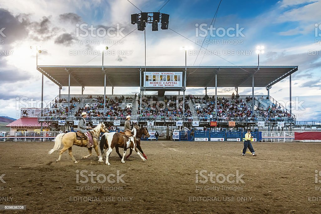 Cowboys riding into Rodeo Arena Cody Stampede Wyoming stock photo