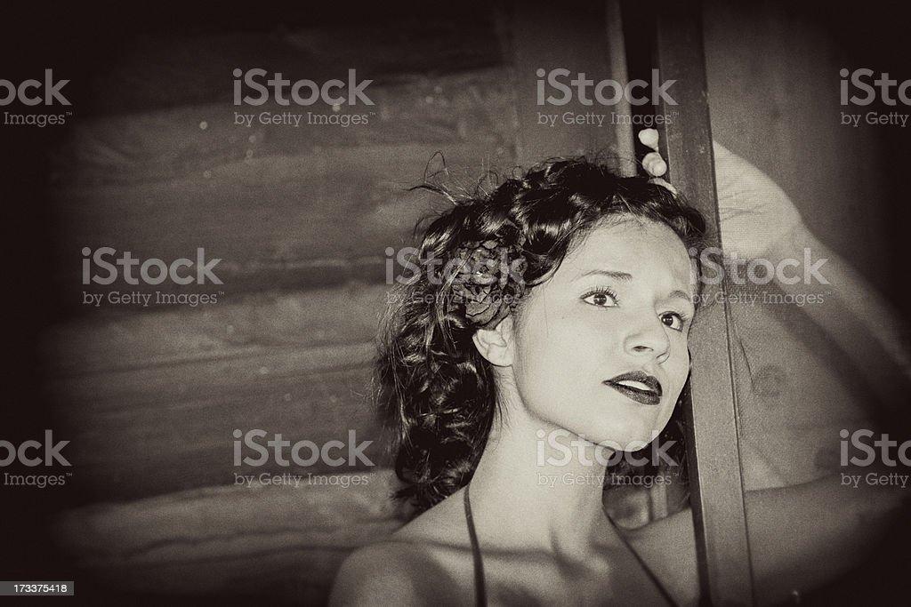 Cowboys: Saloon girl gracefully waiting. Old fashioned sephia tone stock photo