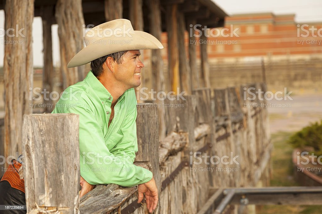 Cowboys:  Texas cowboy looks over Ft. Worth Stockyards. stock photo