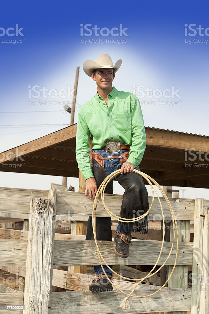 Cowboys:  Texas cowboy prepares for a rodeo event. stock photo