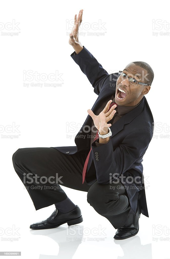 Cowering Business Man Yelling royalty-free stock photo