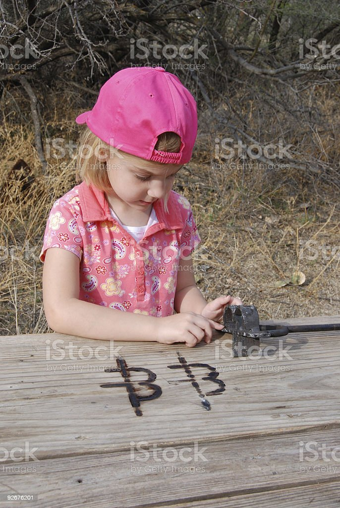 Cowgirl and Brand stock photo
