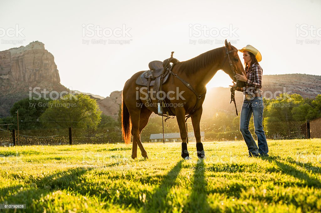 Cowgirl and Horse stock photo