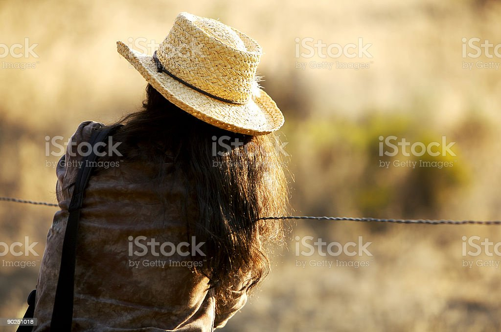 Cowgirl at the Fence royalty-free stock photo