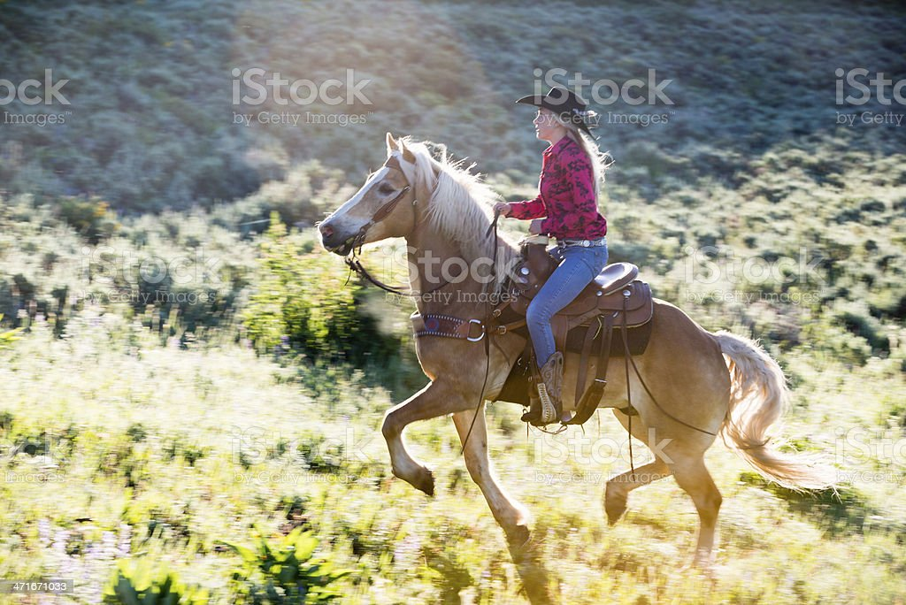 Cowgirl Cantering royalty-free stock photo