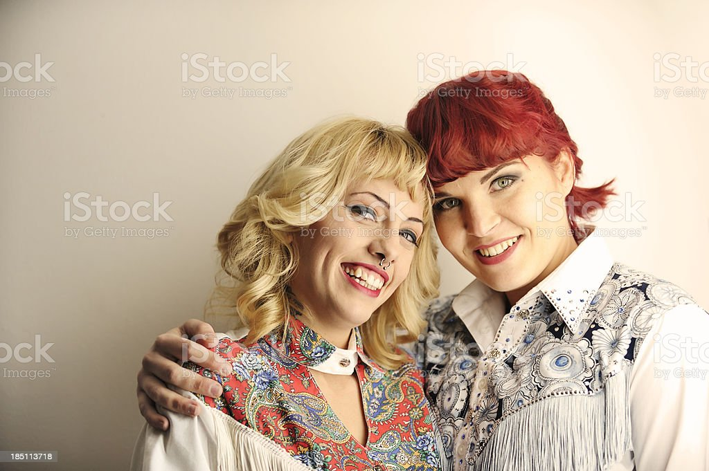 Cowgirl friends posing for the camera stock photo