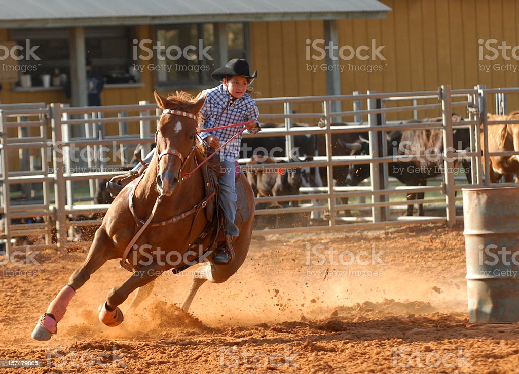 Cowgirl galloping stock photo