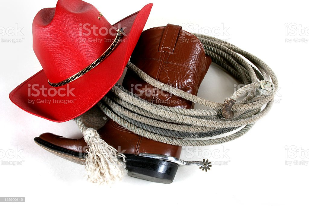 Cowgirl gear - hat, boots, spurs and rope. royalty-free stock photo