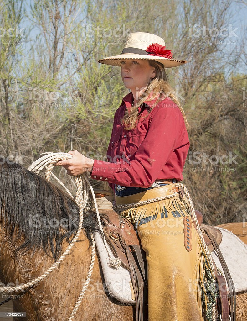 Cowgirl holding lasso on horse royalty-free stock photo