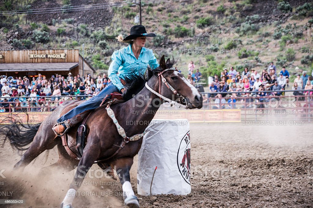 Cowgirl in Rodeo Action stock photo