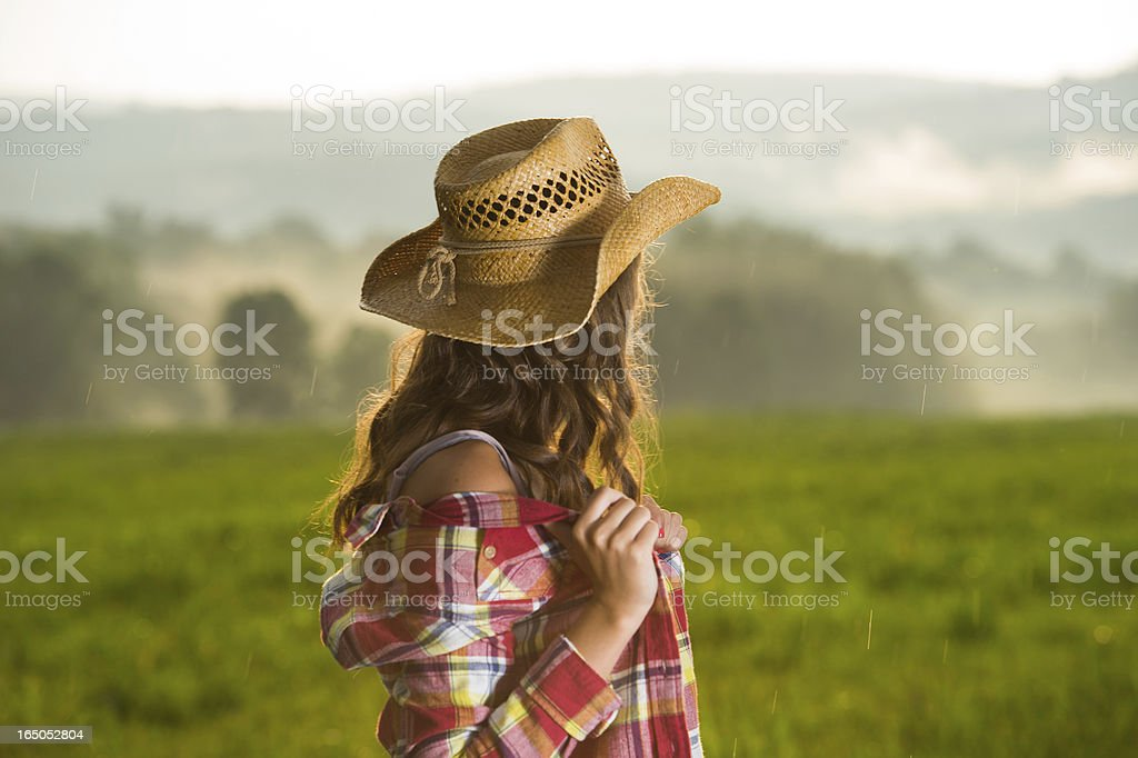 Cowgirl looking at the view after storm stock photo