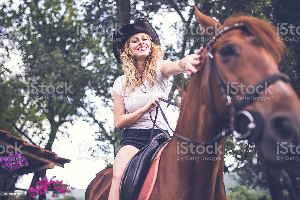 Cowgirl on a horse stock photo