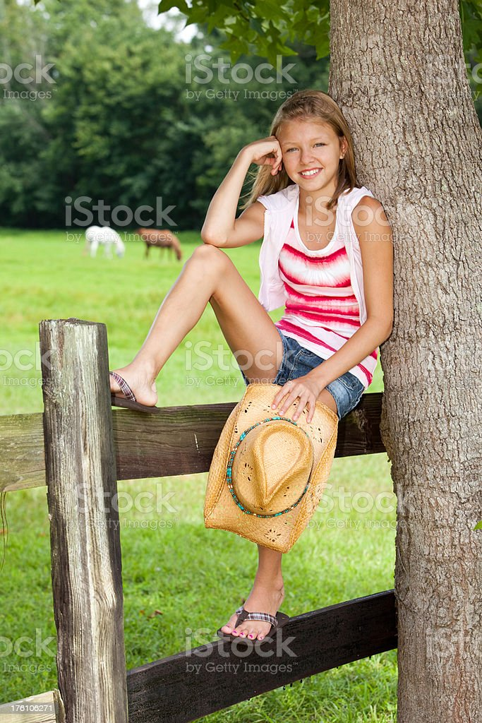 Cowgirl on Fence stock photo