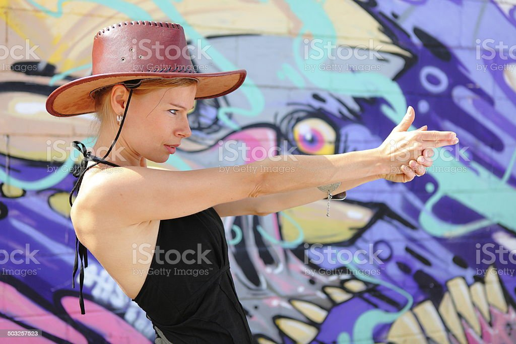 Cowgirl pointing to camera royalty-free stock photo