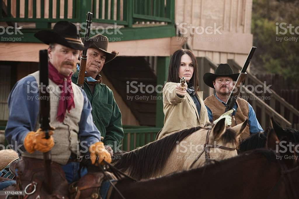 Cowgirl Points Her Pistol stock photo