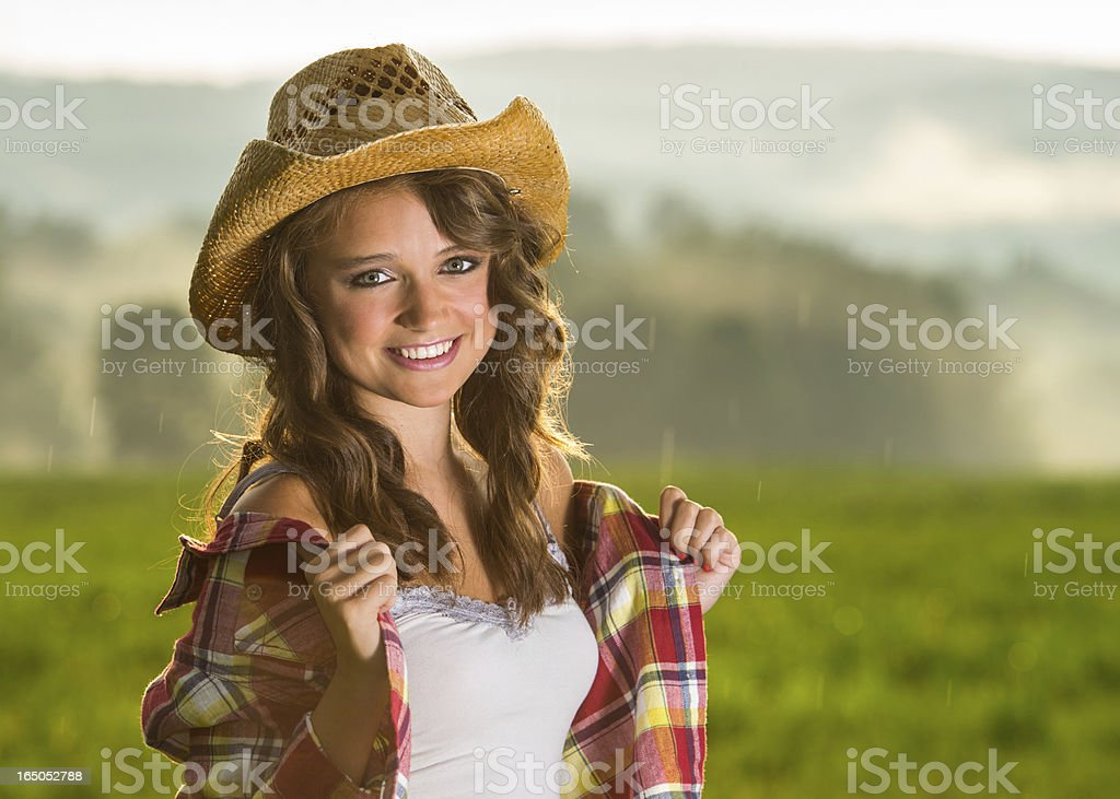 Cowgirl Portait as storm breaks stock photo