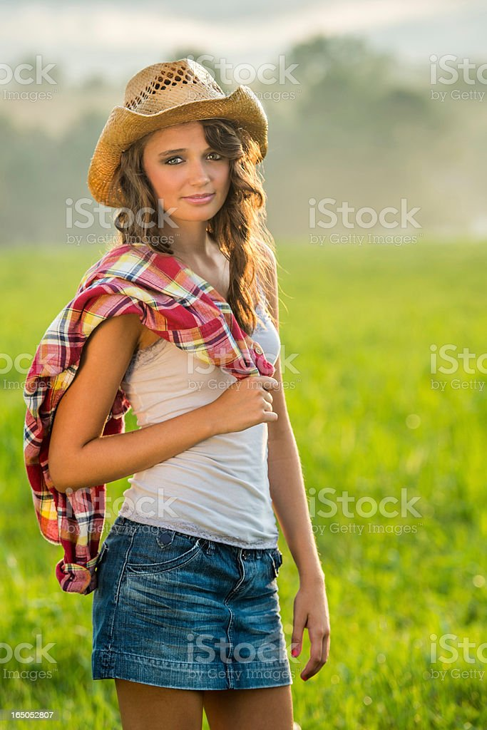 Cowgirl Portait with Foggy Mountain Backdrop stock photo