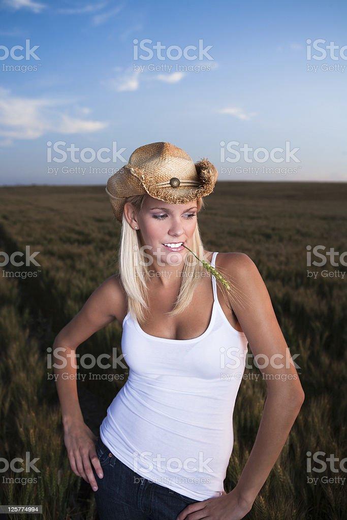 Cowgirl portrait in wheat field stock photo