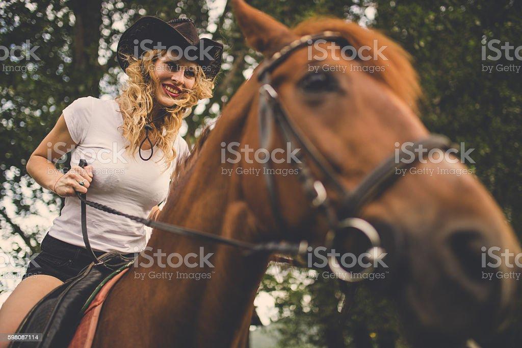 Cowgirl ridding a stallion stock photo