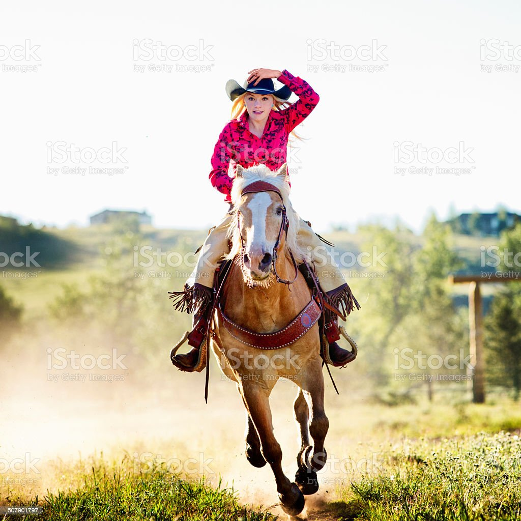 Cowgirl riding fast stock photo