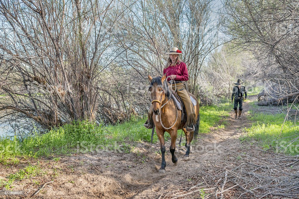 Cowgirl riding trail royalty-free stock photo