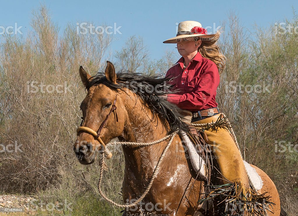 Cowgirl running horse in water royalty-free stock photo