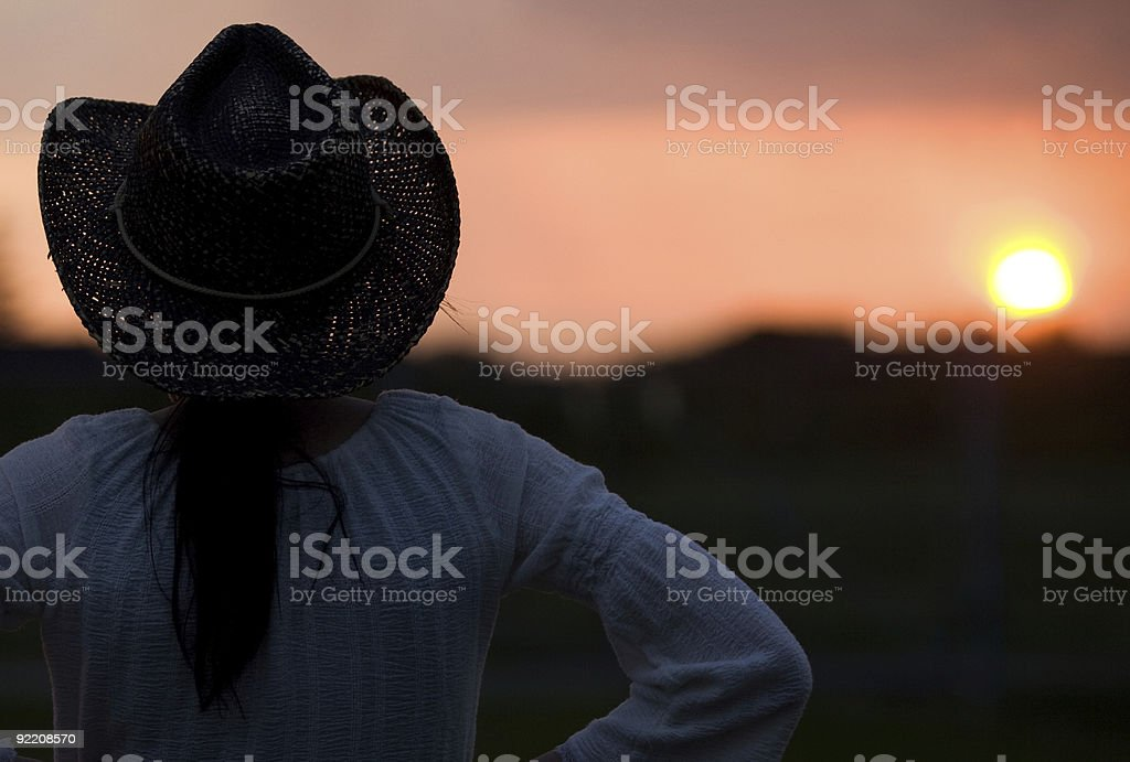 Cowgirl Silhouette at Sunset royalty-free stock photo