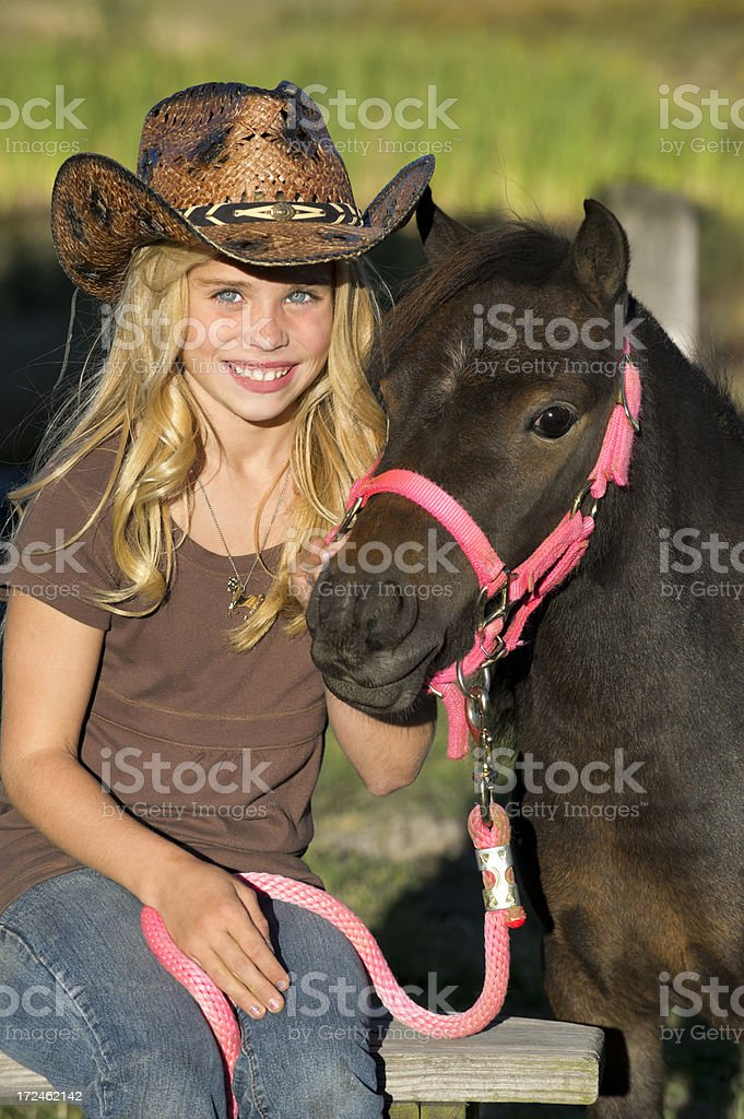Cowgirl Sitting with Her Horse, Cute Blonde Portrait royalty-free stock photo