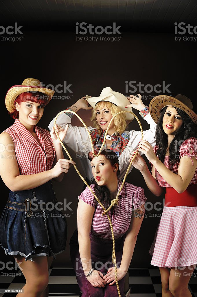 Cowgirl sweethearts with lariat stock photo