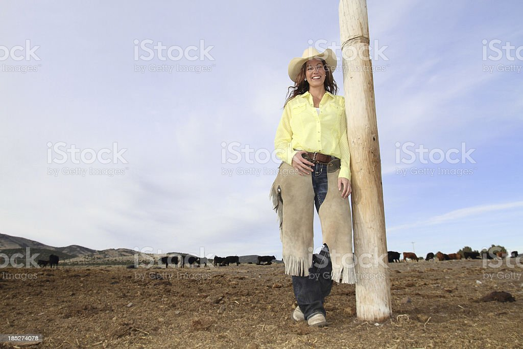 Cowgirl taking a break on the ranch royalty-free stock photo