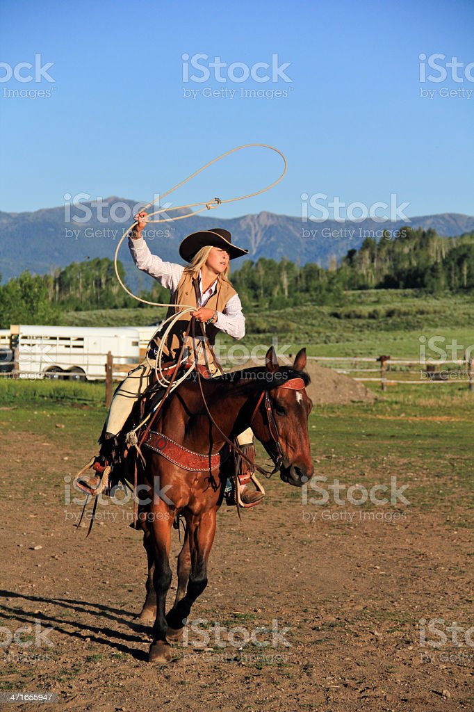 Cowgirl throwing lasso royalty-free stock photo