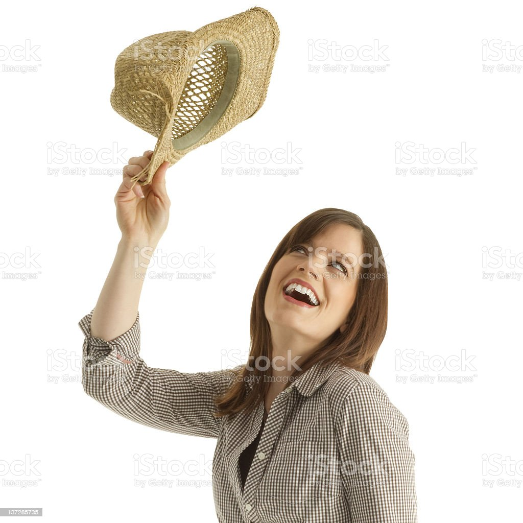 cowgirl tossing her cowboy hat up in the air stock photo