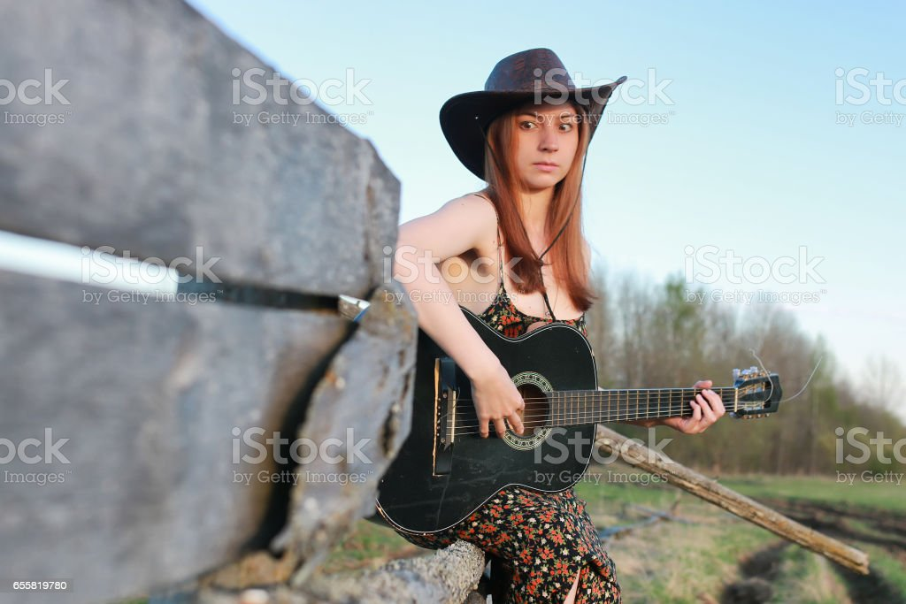 cowgirl un hat with guitar stock photo