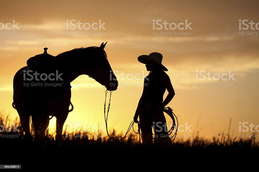 cowgirl walking her horse stock photo