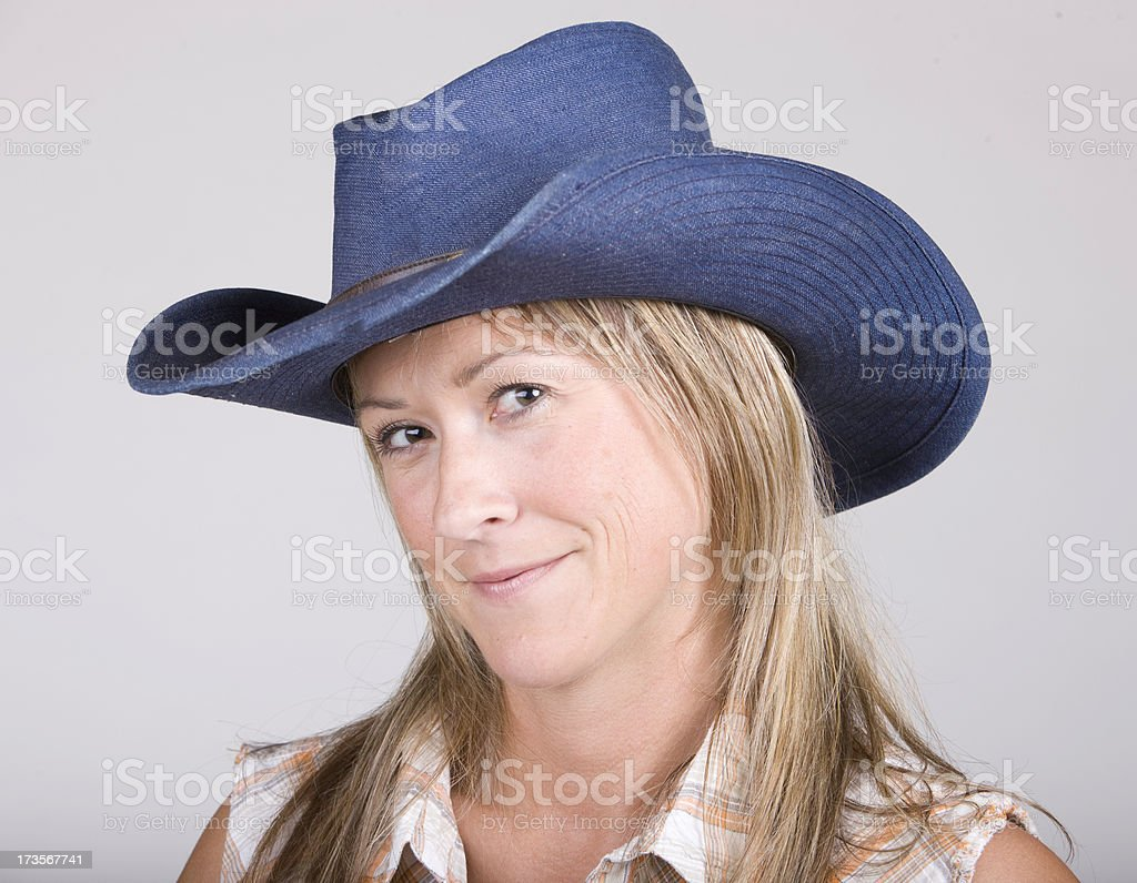 Cowgirl with a Blue Cowboy hat royalty-free stock photo