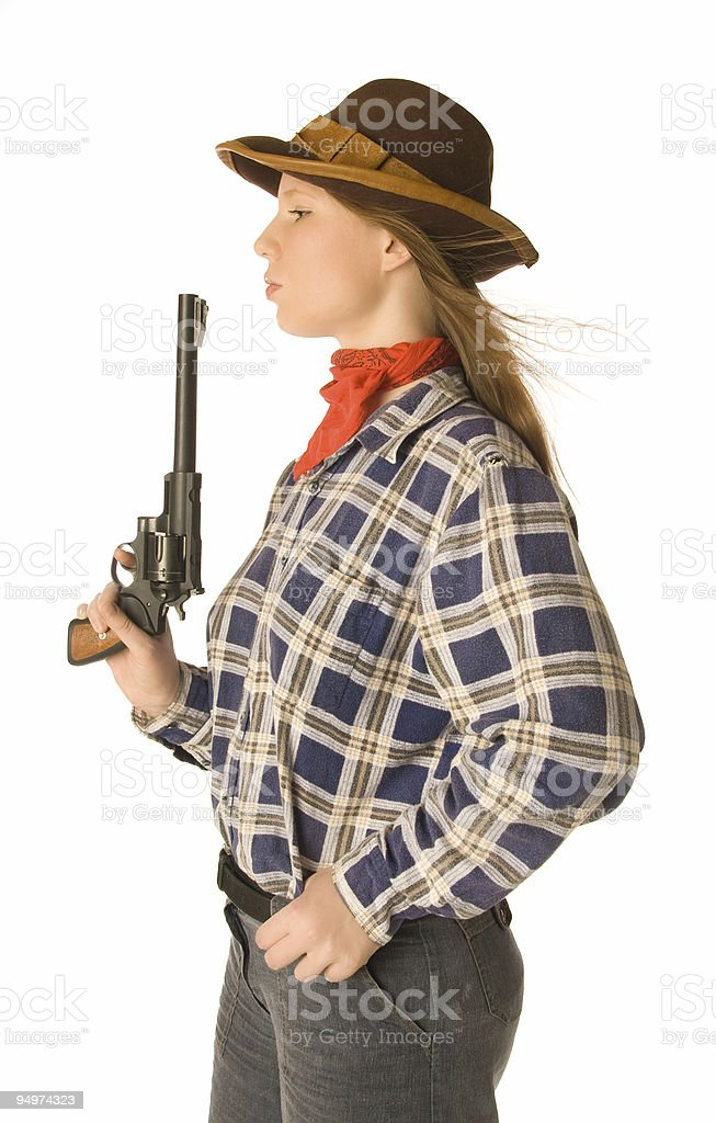 Cowgirl with a gun royalty-free stock photo